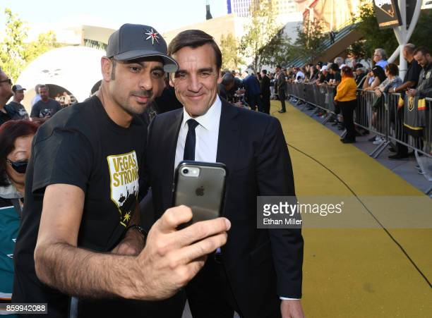 Asif Siddiq of Nevada takes a selfie with Vegas Golden Knights general manager George McPhee as he arrives at the team's inaugural regularseason home...