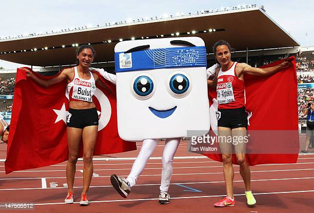 Asil CakirAlptekin of Turkey celebrates with Gamze Bulut of Turkey and mascot Appy after winning the Women's 1500 Metres Final during day five of the...