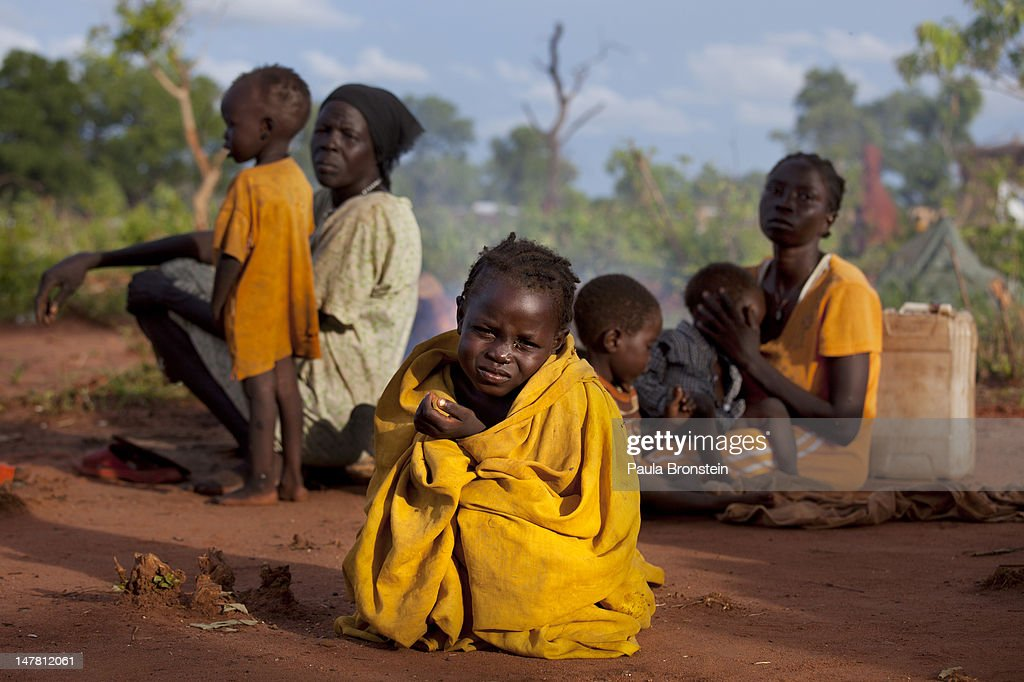 Asimara sits on the ground with her family without shelter after arriving at Yida refugee camp July 2 2012 in Jaw South Sudan Many refugees have been...