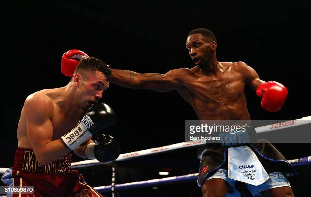 Asina Byfield of Great Britain and Sam McNess of Great Britain exchange blows during their Southern Area SuperWelterweight Championship bout at...