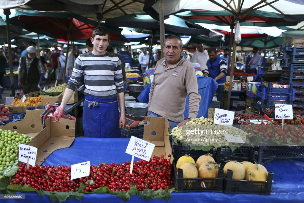 Asir Akdursun (50), a greengrocer poses for a photo with his 18-year-old greengrocer son Serhat Kahraman, who had chosen the same field of profession with his father following his lead, in Ankara, Turkey on June 16, 2017. Fathers, sometimes shape the future of their children directing their career and profession choices.