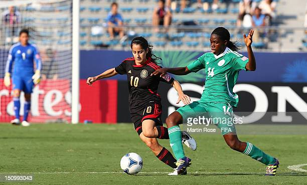Asisat Oshoala of Nigeria and Natalia Gomez Junco of Mexico battle for the ball during the FIFA U20 Women's World Cup Japan 2012 Quarter Final match...