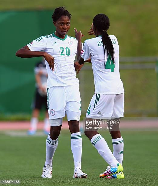 Asisat Oshoala of Nigeria celebrates her team's foourth goal with team mate Uchechi Sunday during the FIFA U20 Women's World Cup Canada 2014 Semi...