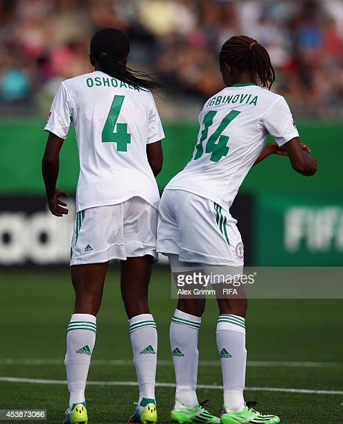 Asisat Oshoala of Nigeria celebrates her team's second goal with team mate Osarenoma Igbinovia during the FIFA U20 Women's World Cup Canada 2014 Semi...