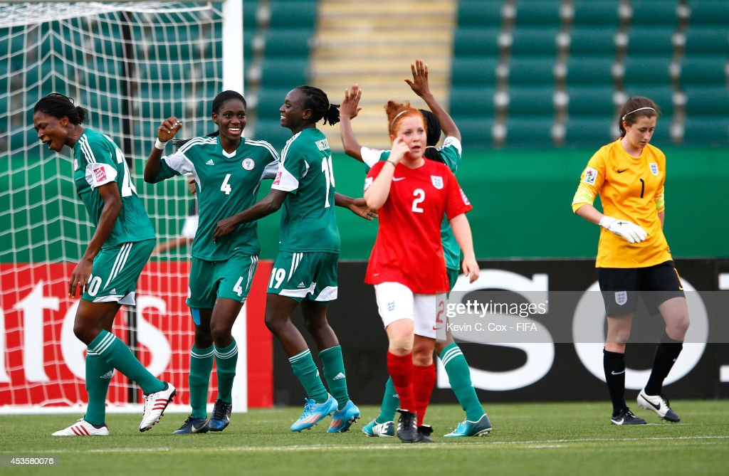 Asisat Oshoala of Nigeria reacts after scoring on a penalty kick past goalkeeper Elizabeth Durack of England during the FIFA U-20 Women's World Cup Canada 2014 Group C match between Nigeria and England at Commonwealth Stadium on August 13, 2014 in Edmonton, Canada.