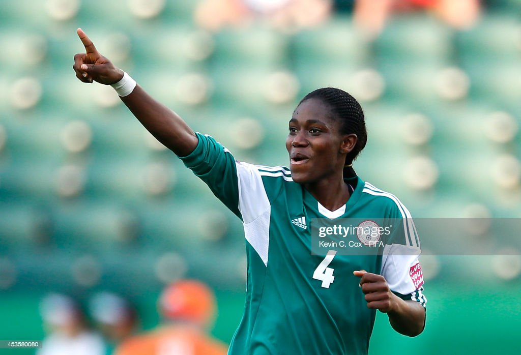Asisat Oshoala of Nigeria reacts after scoring on a penalty kick against England during the FIFA U-20 Women's World Cup Canada 2014 Group C match between Nigeria and England at Commonwealth Stadium on August 13, 2014 in Edmonton, Canada.