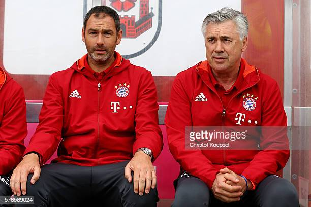 Asistant coach Paul Clement and head coach Carlo Ancelottie of Bayern Muenchen sit on the bench during the friendly match between SV Lippstadt and FC...