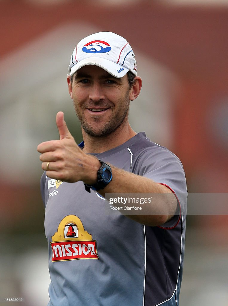Asistant coach <a gi-track='captionPersonalityLinkClicked' href=/galleries/search?phrase=Steven+King+-+Australian+Rules+Football+Player&family=editorial&specificpeople=171910 ng-click='$event.stopPropagation()'>Steven King</a> getsures during a Western Bulldogs AFL training session at Whitten Oval on April 2, 2014 in Melbourne, Australia.