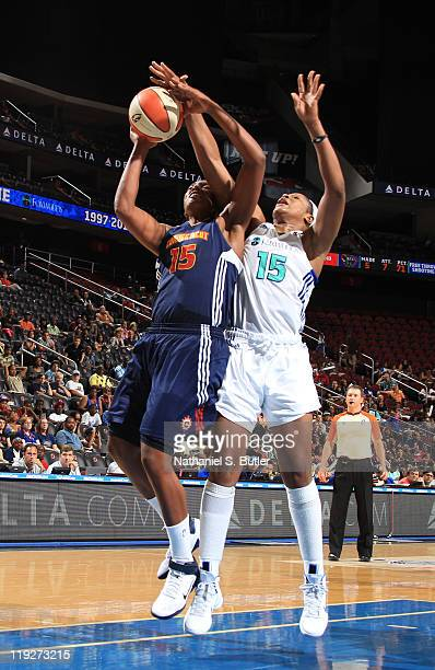 Asjha Jones of the Connecticut Sun is blocked by Kia Vaughn of the New York Liberty during a game on July 15 2011 at the Prudential Center in Newark...