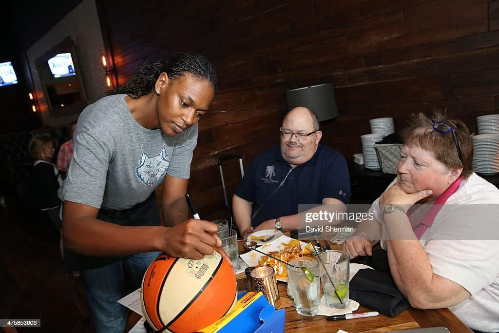 <a gi-track='captionPersonalityLinkClicked' href=/galleries/search?phrase=Asjha+Jones&family=editorial&specificpeople=214644 ng-click='$event.stopPropagation()'>Asjha Jones</a> #15 of the Minnesota Lynx signs autographs during the Tip-A-Lynx fundraiser to benefit the Minnesota Lynx Fastbreak Foundation on June 3, 2015 at the Loop West End Bar & Restaurant in Minneapolis, Minnesota.
