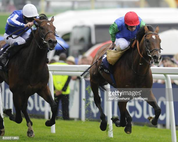 Ask ridden by Ryan Moore wins The Investec Coronation Cup during The Investec Ladies Day at Epsom Racecourse London