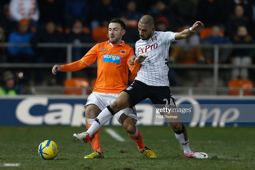 Askan Dejegah of Fulham competes with Neil Eardley of Blackpool during the FA Cup with Budweiser Third Round Replay match between Blackpool and Fulham at Bloomfield Road on January 15, 2013 in Blackpool, England.