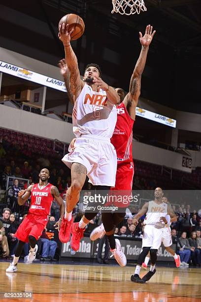 Askia Booker of the Northern Arizona Suns shoots against Gary Payton II of the Rio Grande Valley Vipers on December 9 at Prescott Valley Event Center...