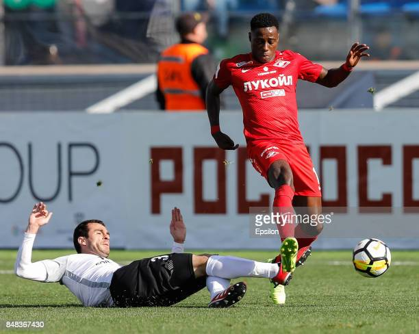Aslan Dudiyev of FC Tosno and Quincy Promes of FC Spartak Moscow vie for the ball during the Russian Football League match between FC Tosno and FC...