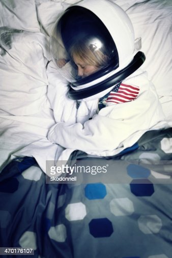 Asleep In Bed Dreaming Of Being An Astronaut Stock Photo