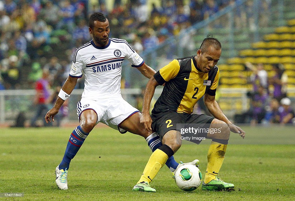 Asley Cole of Chelsea tackles Mahalli bin Jasuli of Malaysia during the match between Chelsea and Malaysia XI on July 21, 2013 at the Shah Alam Stadium in Shah Alam, Kuala Lumpur, Malaysia.