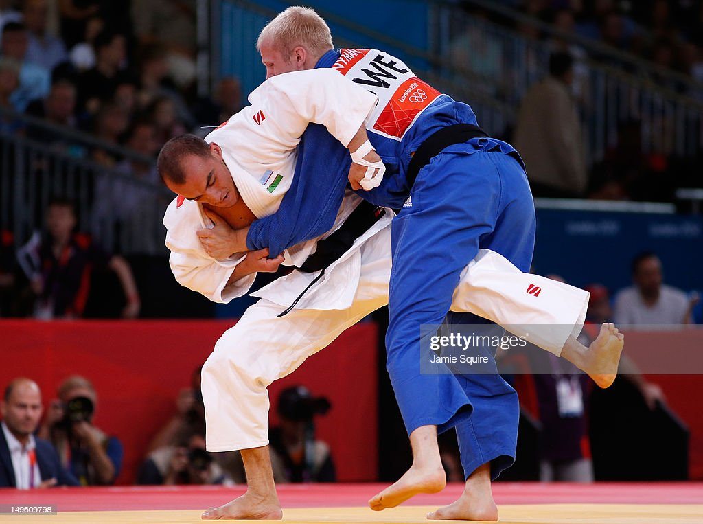 Asley Gonzalez Montero of Cuba (white) competes with Hector Campos of Argentina during the Men's -90 kg Judo on Day 5 of the London 2012 Olympic Games at ExCeL on August 1, 2012 in London, England.
