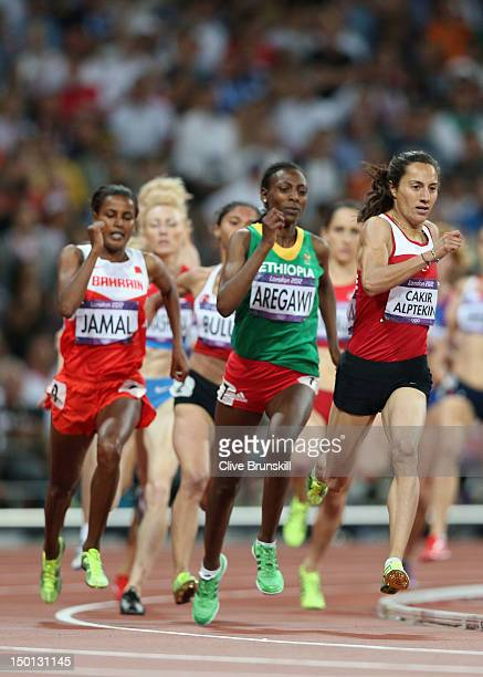 Asli Cakir Alptekin of Turkey leads the pack during the Women's 1500m Final on Day 14 of the London 2012 Olympic Games at Olympic Stadium on August...