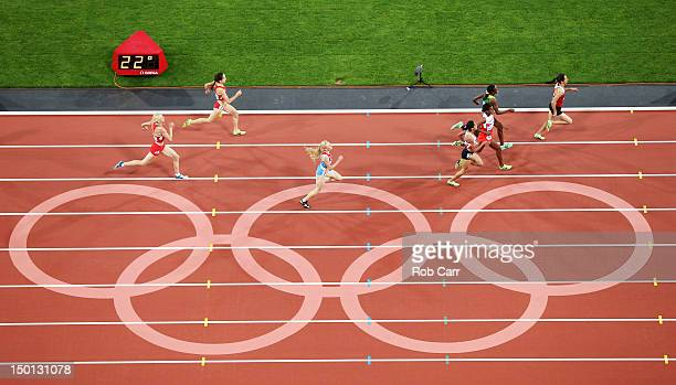 Asli Cakir Alptekin of Turkey races to the finish line during the Women's 1500m Final on Day 14 of the London 2012 Olympic Games at Olympic Stadium...