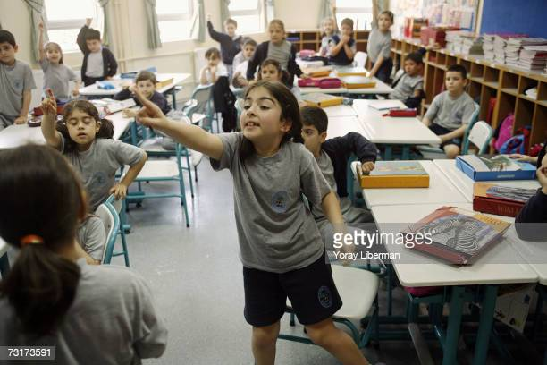 Asli Ozgonul participates in an English lesson on May 22 2006 in Istanbul Turkey Asli takes the school bus from her house on the European side of...