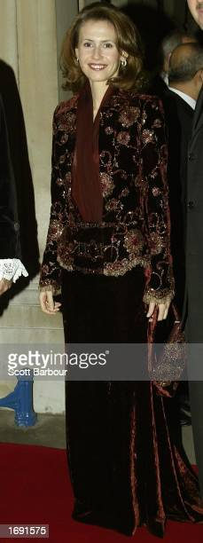 Asma alAssad the Britishborn wife of President Bashar alAssad of Syria poses for photographers as they arrive at the Lord Mayor's Dinner December 17...