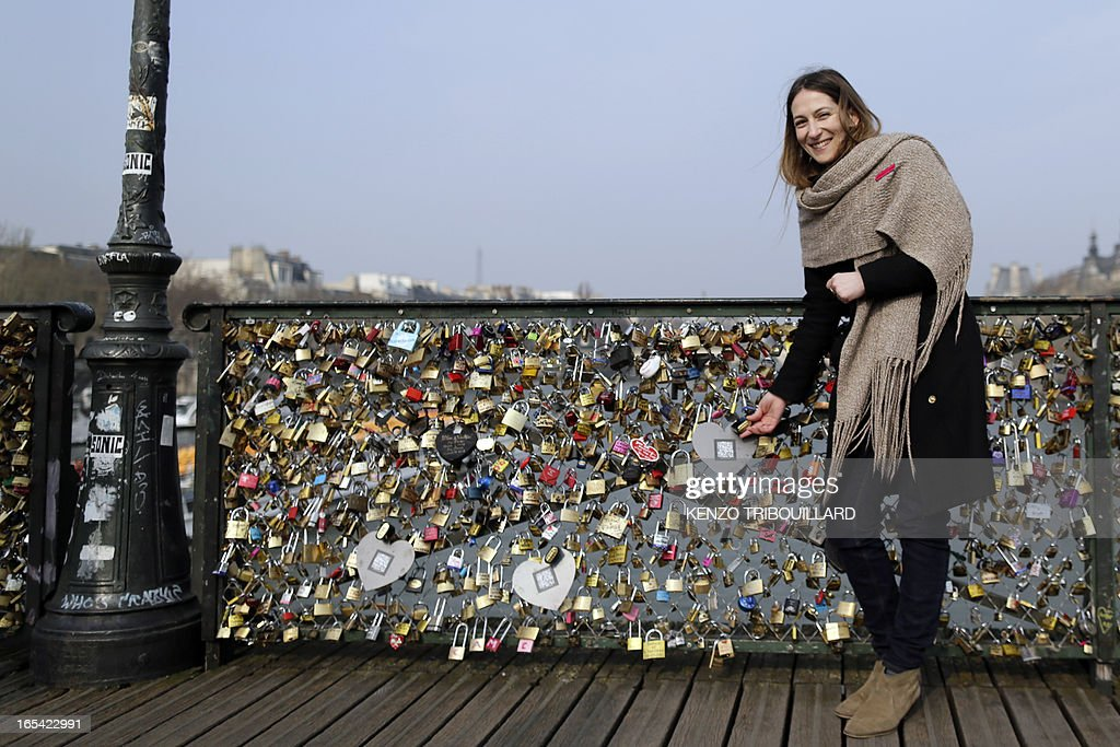 Asma Guenifi, President of French feminist movement 'Ni Putes, Ni Soumises' (Neither Whores Nor Submissive - NPNS) founded in 2002, presents on April 4, 2013 at the'Pont des Arts' in Paris, one of the black heart-shaped padlocks symbolizing abused women which the movement asked individuals to place on the bridge to mark the tenth anniversary of NPNS.