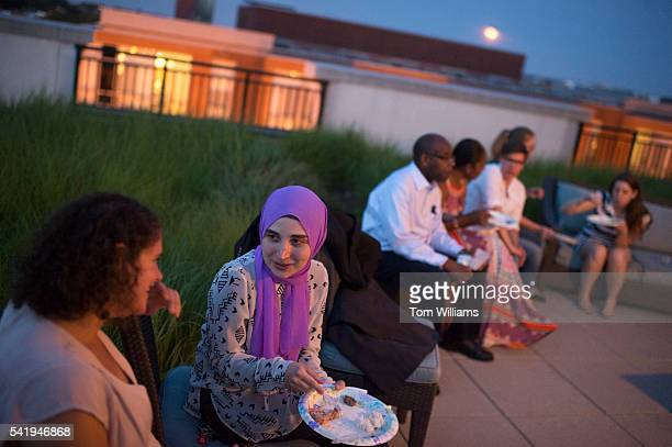 Asmaa Albaroudi second from left attends an iftar dinner on a roof deck in Northeast for those who participated in fasting for Ramadan June 20 2016...