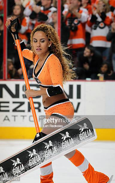 Asmaa Harakat of the Philadelphia Flyers ice girls cleans the ice during a timeout against the Washington Capitals on December 17 2013 at the Wells...