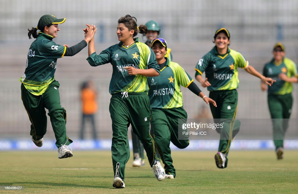 Asmavia Iqbal (L) of Pakistan celebrates the wicket of Jodie Fields of Australia with team-mates during the second match of ICC Womens World Cup between Australia and Pakistan, played at the Barabati stadium on February 1, 2013 in Cuttack, India.