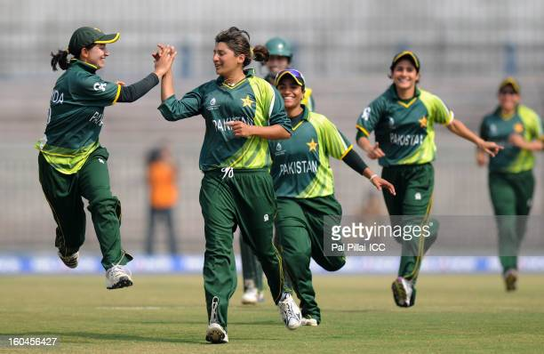 Asmavia Iqbal of Pakistan celebrates the wicket of Jodie Fields of Australia with teammates during the second match of ICC Womens World Cup between...