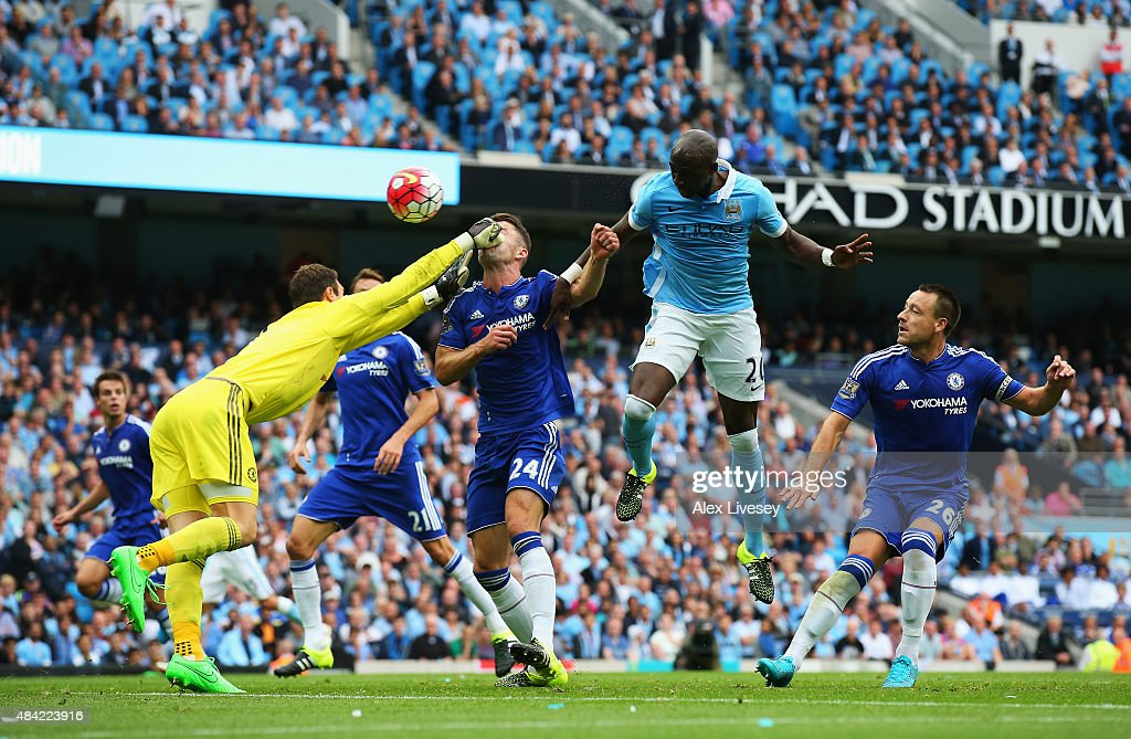 Asmir Begovic of Chelsea punches Gary Cahill of Chelsea in the face as he attempts to clear during the Barclays Premier League match between Manchester City and Chelsea at the Etihad Stadium on August 16, 2015 in Manchester, England.