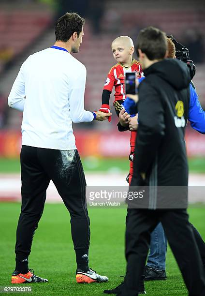 Asmir Begovic of Chelsea speaks to Bradley Lowrey during the warm up during the Premier League match between Sunderland and Chelsea at Stadium of...