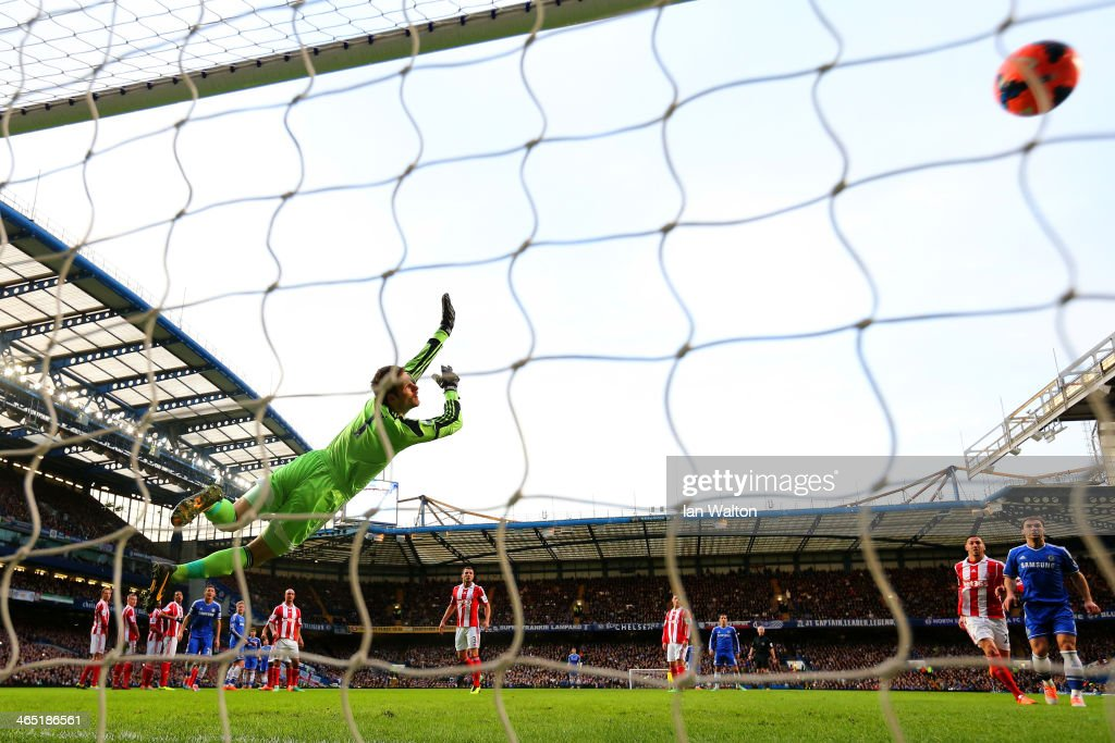 <a gi-track='captionPersonalityLinkClicked' href=/galleries/search?phrase=Asmir+Begovic&family=editorial&specificpeople=4184467 ng-click='$event.stopPropagation()'>Asmir Begovic</a> of Stoke City fails to stop Oscar of Chelsea (obstructed) score the opening goal from a free kick during the FA Cup Fourth Round between Chelsea and Stoke City at Stamford Bridge on January 26, 2014 in London, England.