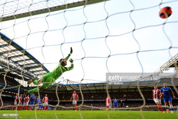 Asmir Begovic of Stoke City fails to stop Oscar of Chelsea score the opening goal from a free kick during the FA Cup Fourth Round between Chelsea and...