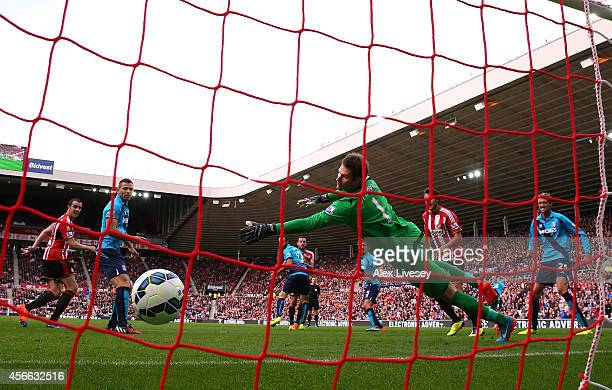 Asmir Begovic of Stoke City is beaten by a header from Steven Fletcher of Sunderland for a goal during the Barclays Premier League match between...