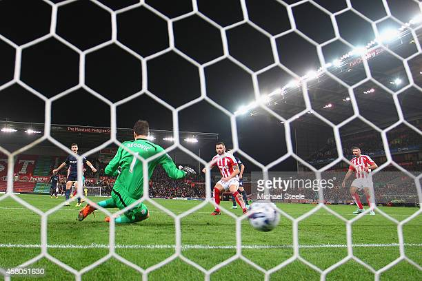 Asmir Begovic of Stoke City is beaten by a shot from Shane Long of Southampton to concede the second goal during the Capital One Cup Fourth Round...