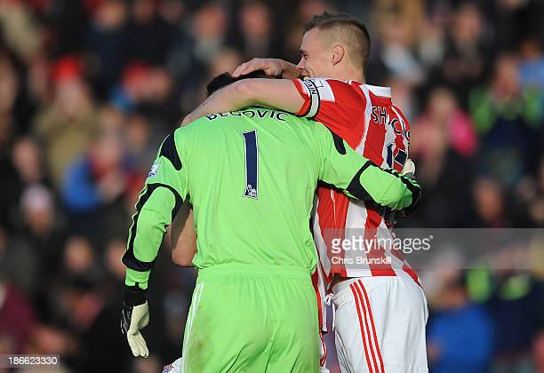 Asmir Begovic of Stoke City is congratulated by teammate Ryan Shawcross after scoring the opening goal during the Barclays Premier League match...