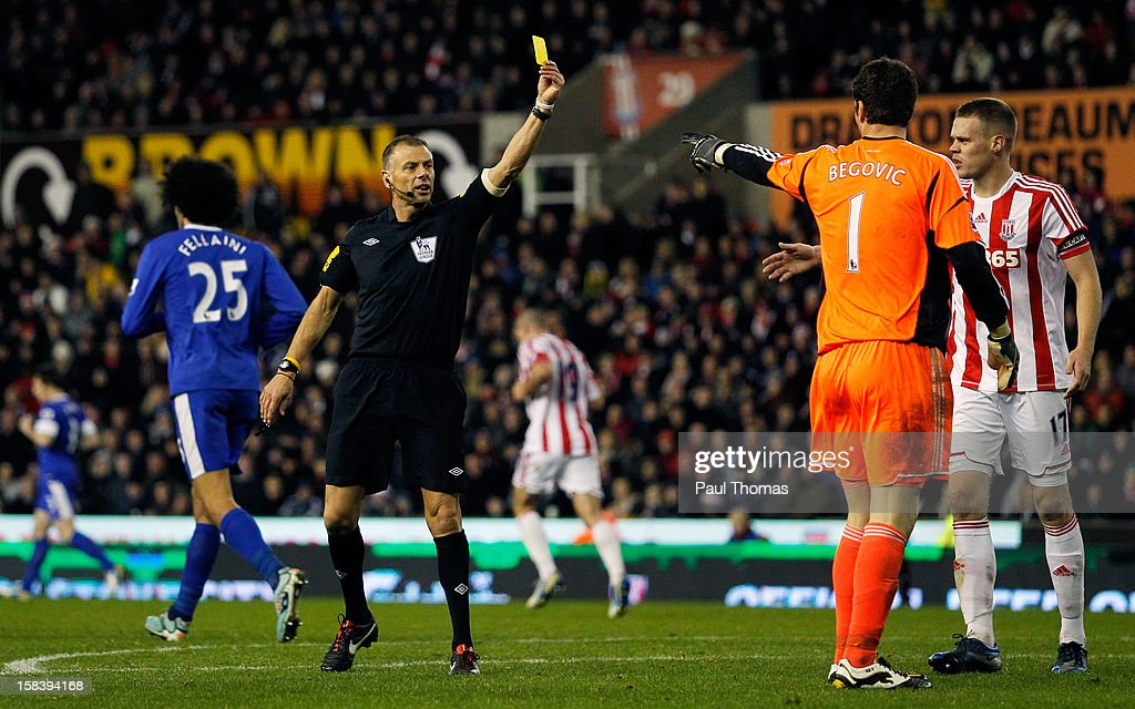 <a gi-track='captionPersonalityLinkClicked' href=/galleries/search?phrase=Asmir+Begovic&family=editorial&specificpeople=4184467 ng-click='$event.stopPropagation()'>Asmir Begovic</a> of Stoke City receives a yellow card from referee <a gi-track='captionPersonalityLinkClicked' href=/galleries/search?phrase=Mark+Halsey&family=editorial&specificpeople=224397 ng-click='$event.stopPropagation()'>Mark Halsey</a> during the Barclays Premier League match between Stoke City and Everton at the Britannia Stadium on December 15, 2012, in Stoke-on-Trent, England.