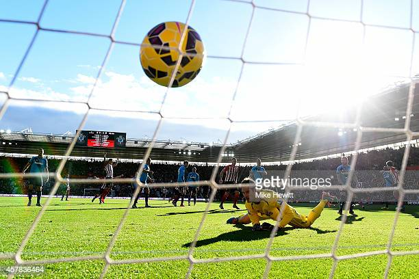 Asmir Begovic of Stoke City watches the ball cross the line as Sadio Mane of Southampton scores the opening goal during the Barclays Premier League...
