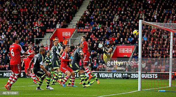 Asmir Begovic of Stoke watches Ricky Lambert's free kick fly past him to make it 10 during the Barclays Premier League match between Southampton and...