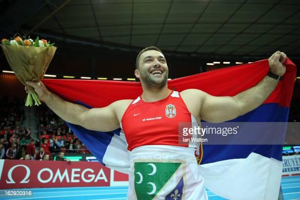 Asmir Kolasinac of Serbia celebrates winning gold in the Men's Shot Put Finalduring day one of the European Athletics Indoor Championships at...