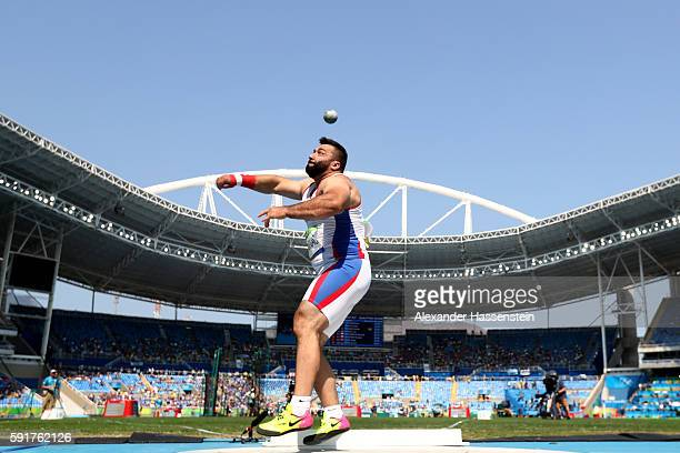 Asmir Kolasinac of Serbia competes in Men's Shot Put Qualifying on Day 13 of the Rio 2016 Olympic Games at the Olympic Stadium on August 18 2016 in...