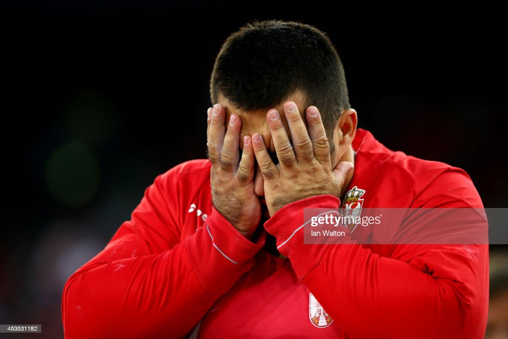 <a gi-track='captionPersonalityLinkClicked' href=/galleries/search?phrase=Asmir+Kolasinac&family=editorial&specificpeople=6836640 ng-click='$event.stopPropagation()'>Asmir Kolasinac</a> of Serbia reacts in the Men's Shot Put final during day one of the 22nd European Athletics Championships at Stadium Letzigrund on August 12, 2014 in Zurich, Switzerland.