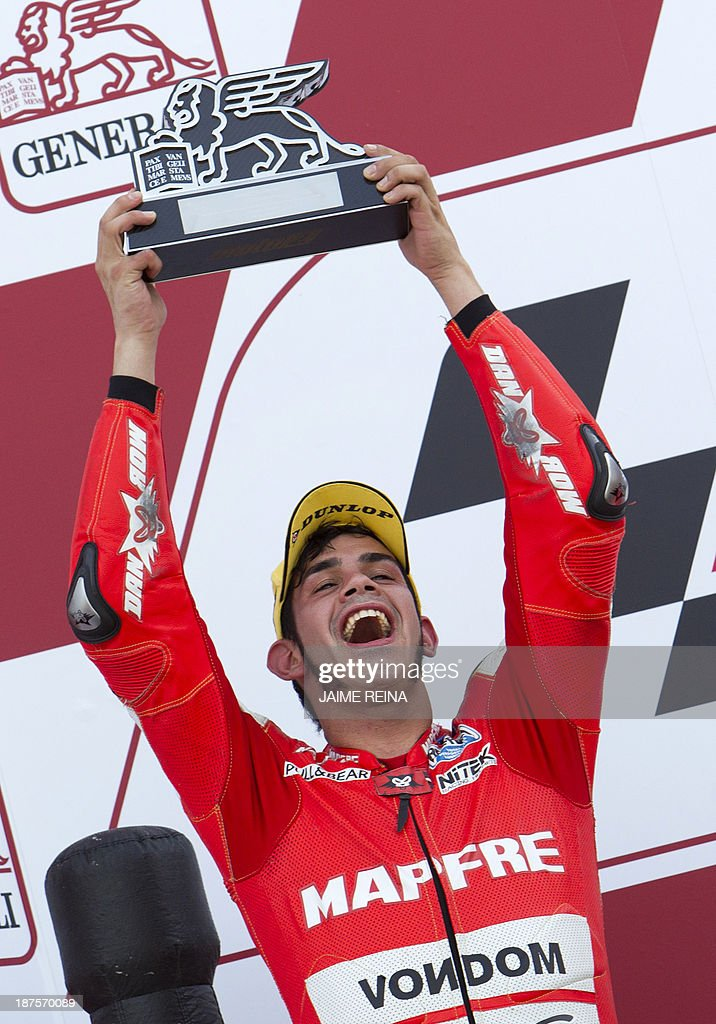 Aspar Team's Spanish rider Jordi Torres celebrates with his trophy after taking second place on the podium the Moto 2 race of the Valencia Grand Prix at Ricardo Tormo racetrack in Cheste, near Valencia, on November 10, 2013.