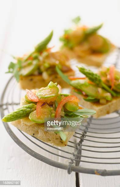 Asparagus bruschetta on grid, close up
