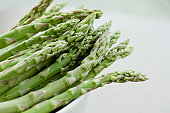 Asparagus in bowl, close up, elevated view