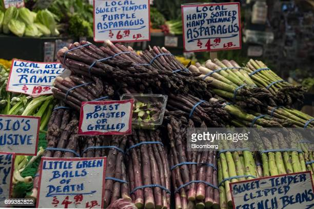 Asparagus is displayed for sale inside the Pike Place Market in Seattle Washington US on Wednesday May 17 2017 Bloomberg is scheduled to release...