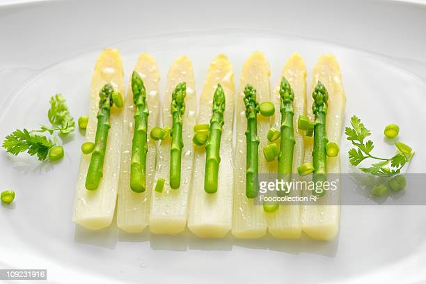 Asparagus salad with spring onions and chervil in tray