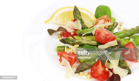Asparagus salad with tomatoes. : Stock Photo