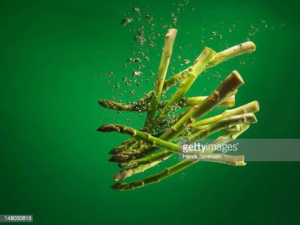 asparagus splashed into water